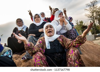 Suruc, Turkey - October 22, 2014. Kurdish women react during a funeral of Kurdish fighters, killed while fighting ISIS forces in Kobani, Syria, at a cemetery in Suruc, on the Turkey-Syria border.