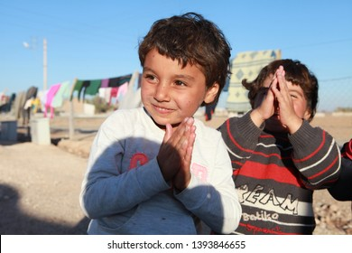 SURUC, TURKEY- Syrian Kurds fleeing the town of Kobane in fear of an State attack, stay at the Municipality of Suruc Tent City. There are also many children from Syria. November 7, 2014