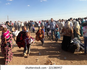 SURUC, TURKEY-SEPTEMBER 20, 2014: Turkey opened its border to Syrians fleeing the town of Kobane in fear of an Islamic State attack. Tens of thousands have fled to Turkey on september 20, 2014.
