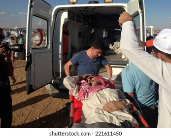 SURUC, TURKEY-SEPTEMBER 20, 2014: Turkey opened its border to Syrians fleeing the town of Kobane in fear of an Islamic State attack. Tens of thousands have fled to Turkey. A view of patient Syrian.