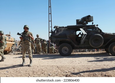 SURUC, TURKEY-SEPTEMBER 21, 2014: Turkey opened its border to Syrians fleeing the town of Kobane in fear of an Islamic State attack. Turkish soldiers at the border. on september 21, 2014.
