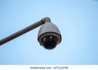 Surveillance camera in brick wall
