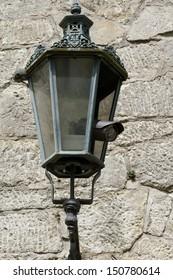 Surveillance camera hidden a an antique lantern - Shutterstock ID 150780614