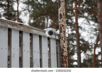 The surveillance camera is installed at the corner of the perimeter of the residential complex.
