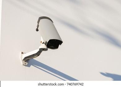 Surveillance camera mounted on a wall