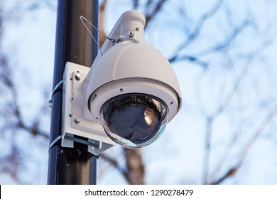 surveillance camera on a pole outside in the park