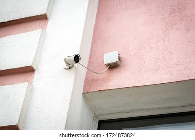 Surveillance camera on the wall of the building outdoor.