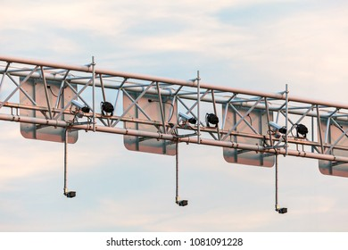Surveillance camera system above a Dutch highway during sunset