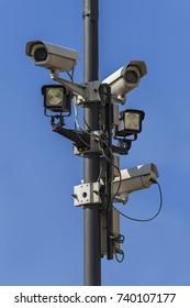 Surveillance camera under a blue sky