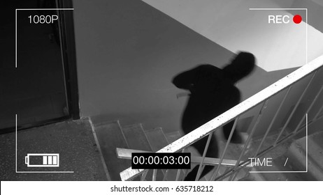 surveillance cameras caught the fleeing robber in a mask and a crowbar.