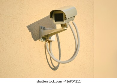 Surveillance, CCTV, security camera installed on a wall - great for topics like safety, security etc.