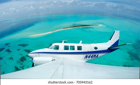 Surveillance plane flies over Helen Island, Palau.