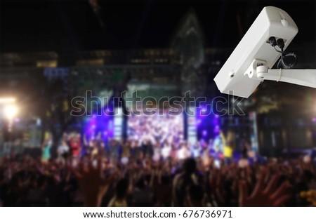Rock Camera Surveillance : Surveillance security camera cctv blurred concert stock photo edit