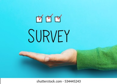 Survey concept with hand on blue background