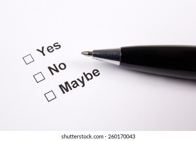 survey with yes, no, maybe answers and metal pen