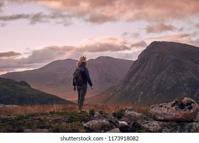 Surveying majestic Scottish Highland views from a peak at sunrise