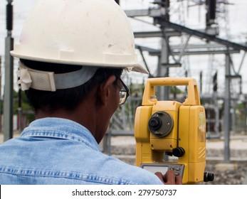 Surveyor engineer on the substation