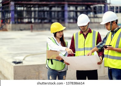 surveyor engineer with theodolite at construction site during surveying work.engineer and architect working at construction site with blueprint