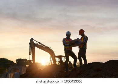 Surveyor engineer worker making measuring with theodolite on road works.survey engineer in construction site.