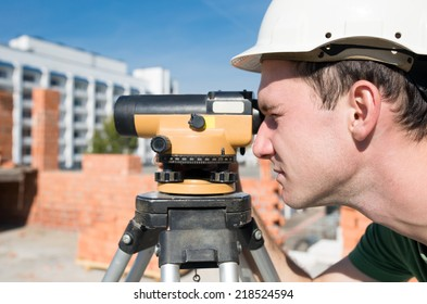 Surveyor engineer worker making measuring with theodolite tool equipment at construction site