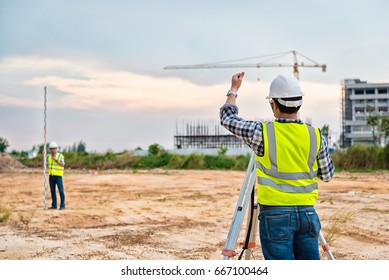 Surveyor Engineering. Surveyor's telescope at construction site. Surveying for making contour plans are a graphical representation of the lay of the land before startup construction work