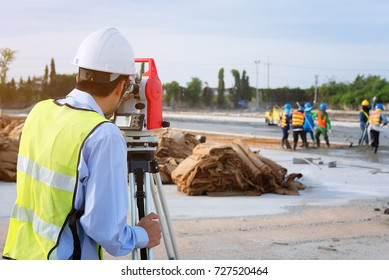 Surveyor engineers using an altometer at Construction Site.teamwork concept.