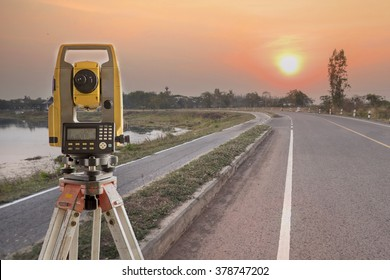 Surveyor equipment tacheometer or theodolite outdoors at construction road