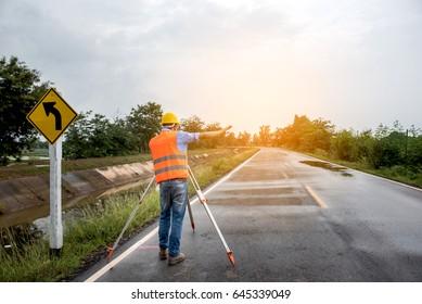 Surveyor equipment tacheometer or theodolite worker on the road.