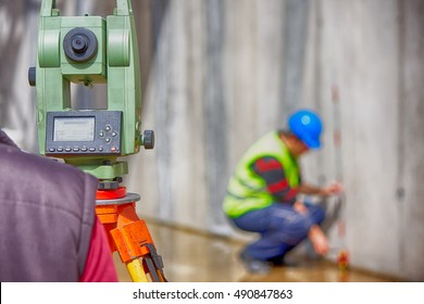 Surveyor equipment tachometer or theodolite outdoors at construction site