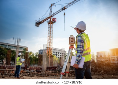 Surveyor equipment. Surveyor's telescope at construction site or Surveying for making contour plans is a graphical representation of the lay of the land startup construction work. - Shutterstock ID 1247187910