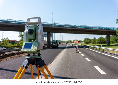 Surveyor equipment (theodolite) on construction site of highway or road