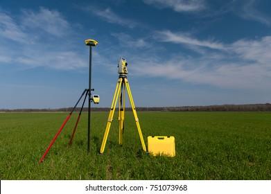 Surveyor equipment theodolite on a tripod with gps