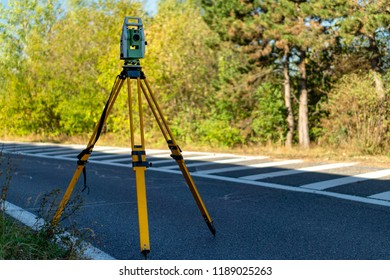 Surveyor equipment (theodolite or total positioning station) on the construction site of the highway or road