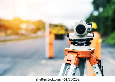 Surveyor telescope at new road construction site