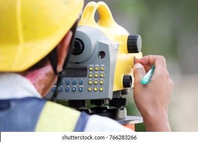 Surveyor working with digital level