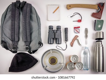 Survival Bug Out Bag. Checklist for things / gears you need to survive in the wilderness or after the apocalypse. A backpack, ax, binoculars, compass, first aid, etc.