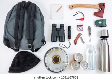 Survival gears for hiking adventures. Camping set / kit. A bug out bag / backpack, ax, binoculars, compass, first aid, etc.