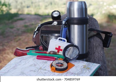 Survival kit in nature background