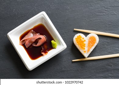 Sushi abstract seafood heart concept on black marble menu background