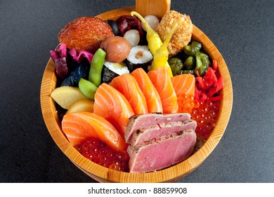 Sushi arranged on a traditional sushi tray.