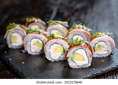 Sushi with avocado and fresh fish