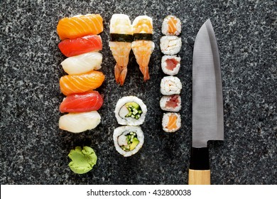 sushi background with Sushi Set nigiri and sushi Rolls, Maki, Wasabi, Knife