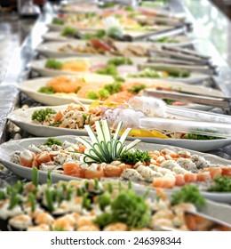 SUSHI BAR - A shallow depth of field image looking along a sushi buffet bar