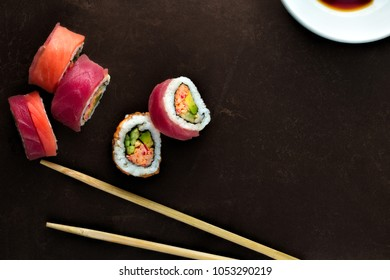 Sushi and chopsticks with negative space