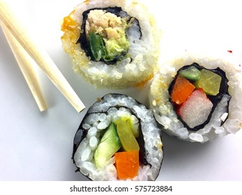 Sushi and chopsticks on a white plate