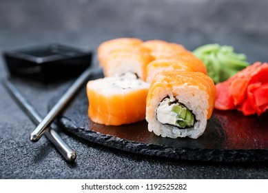 Sushi with chopsticks. Sushi roll japanese food on a table
