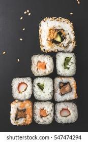Sushi close-up on black surface