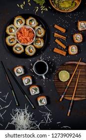 Sushi composition styling on black background