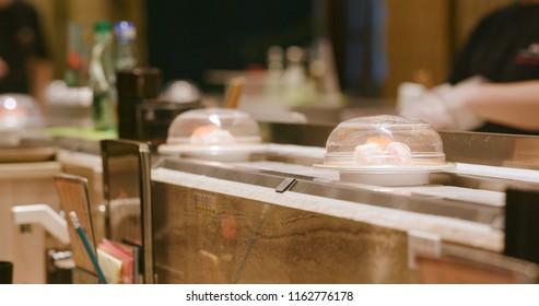 Sushi conveyor belt in Japanese sushi restaurant