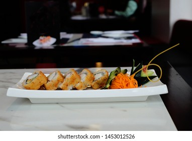 Sushi is a dish of Japanese origin based on rice seasoned with rice vinegar, sugar and salt and combined with other ingredients such as fish, seafood and vegetables.